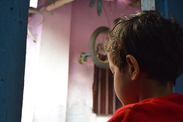 The view from Angad's window is an alley where he and his neighbors get their water.