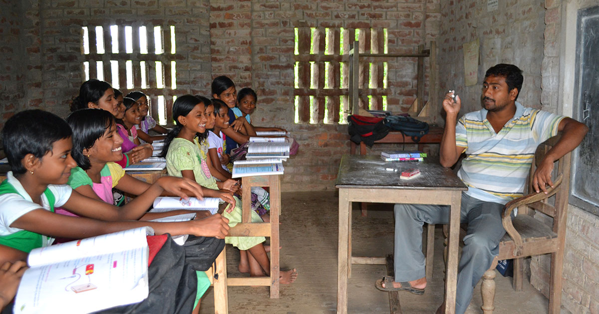 Kids in an Indian school listen as their teacher talks