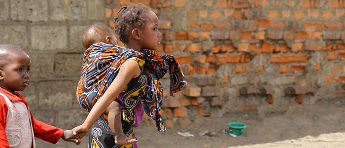 Zambian girl and boy in urban poverty setting.