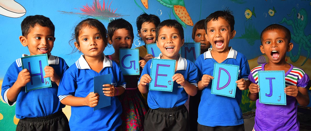 Sponsored children in India are excited to learn ABCs through a CI early childhood education program