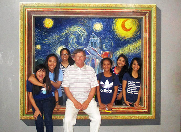 Chris Kent visits a museum with his sponsored kids in the Philippines.