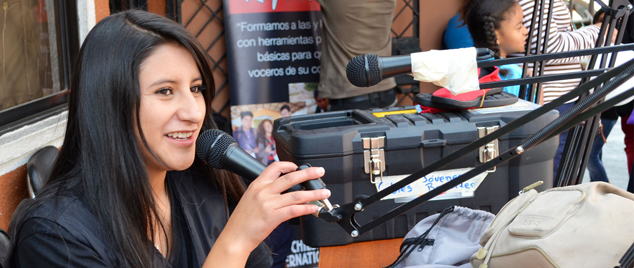 A girl in CI's Community Youth Reporter program in Ecuador prepares for a radio broadcast