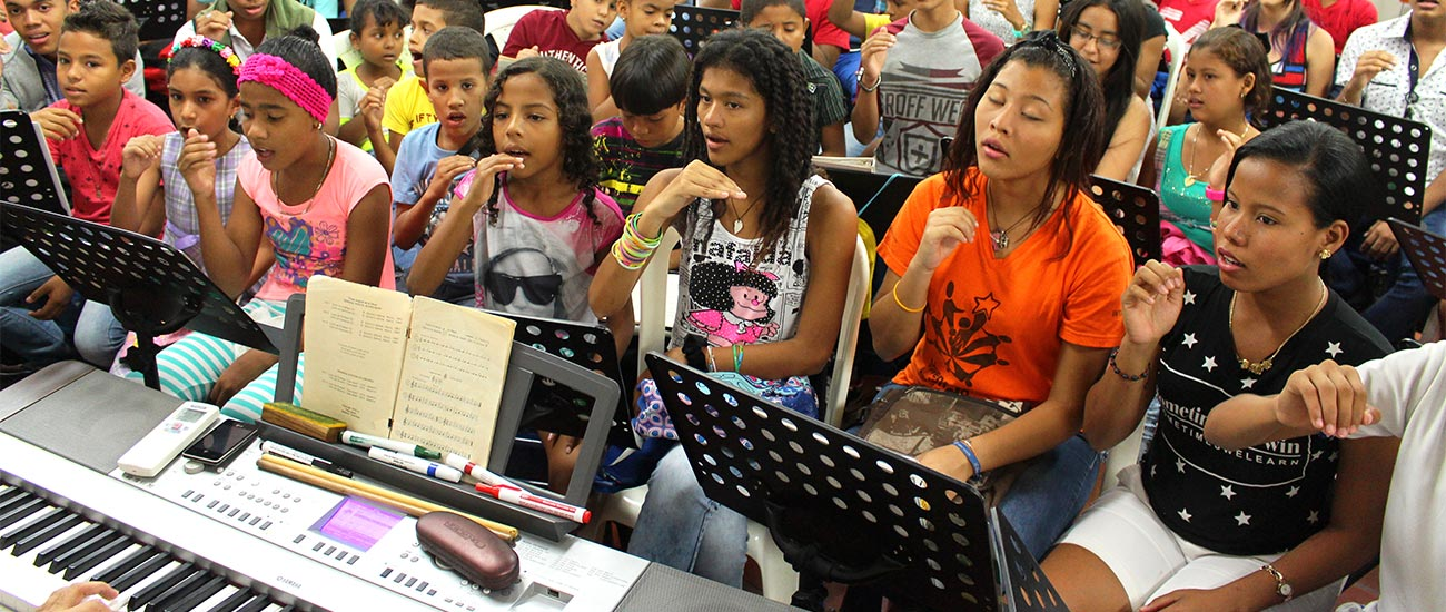 Sponsored kids in Colombia sing in music program
