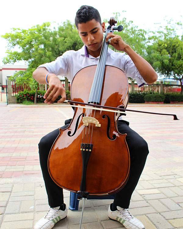 Colombian teen playing the cello