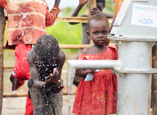 Kids in South Sudan using the water well