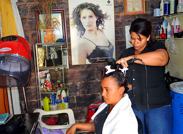 Former sponsored child provides hairstyling services at her beauty salon in the Dominican Republic.
