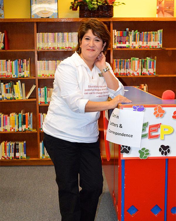 Children International staff member Yolanda in the library