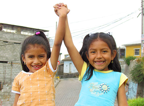 Girls in Quito hold hands