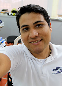 CI computer educator Jesús, role model for kids in Colombia.