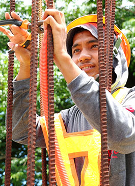 In the Philippines, Jomarie is a building wire technician. He brings in $240 per month.