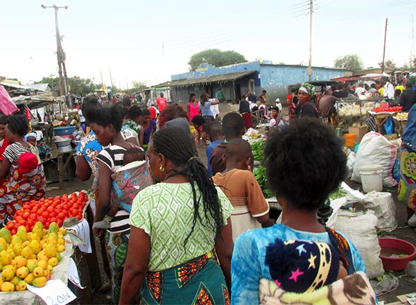 Crowds of mothers and kids converge on the market in Lusaka, Zambia