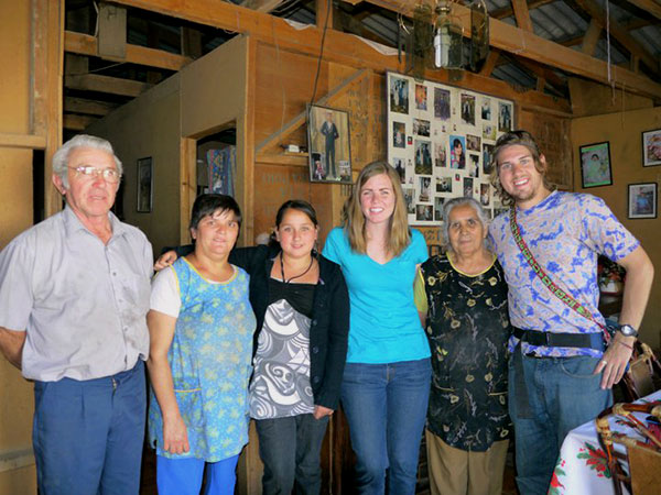 Shalynn and Adam pose for a final photograph with Bernardita and her family