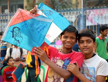 Kids show off their homemade kites