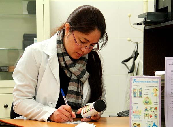 Dr. Jessica Valdez takes notes at her desk