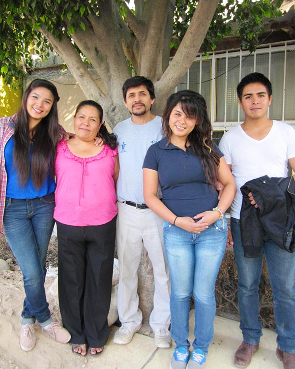 Tania with her mom, dad, older sister Karina and older brother Luis