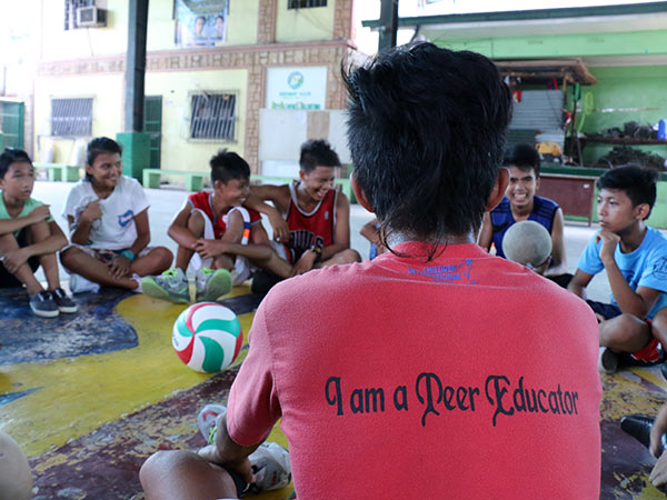 A Youth Health Corps peer educator leads a workshop in the Philippines