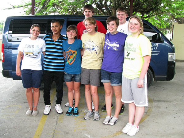 Mary's students pose with Edgar in front of the CI van.