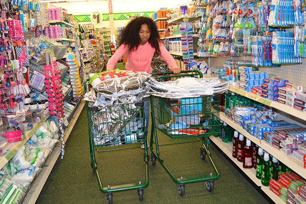 Kelli shops for care kit items that were distributed to the homeless at a Little Rock, Arkansas, Salvation Army last year.