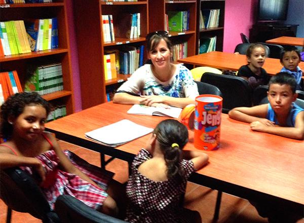 Angela Cervantes meets with children at a San Pedro Sula, Honduras, community center.