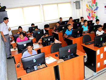 o	Children and teens take advantage of the technology in Children International's computer labs.