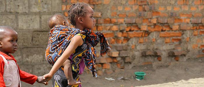 Zambian girl and boy in urban poverty setting.