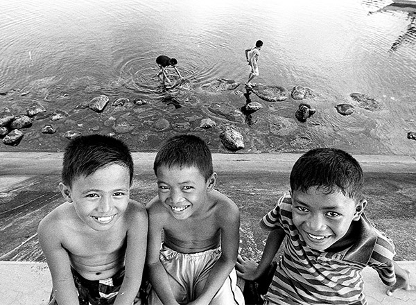Mark (10, middle) and his two friends are hanging out in a sea port after school.