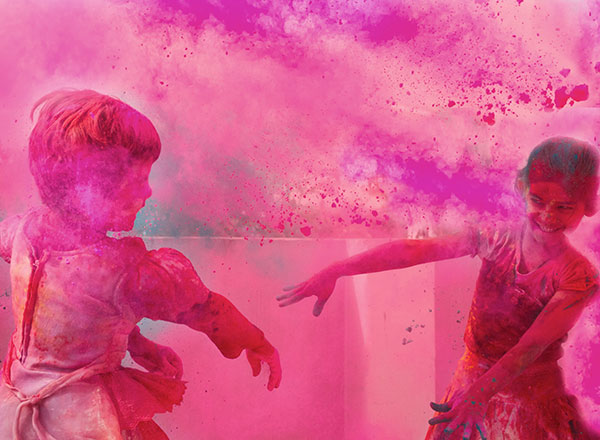 Girls play during the Holi festival in India