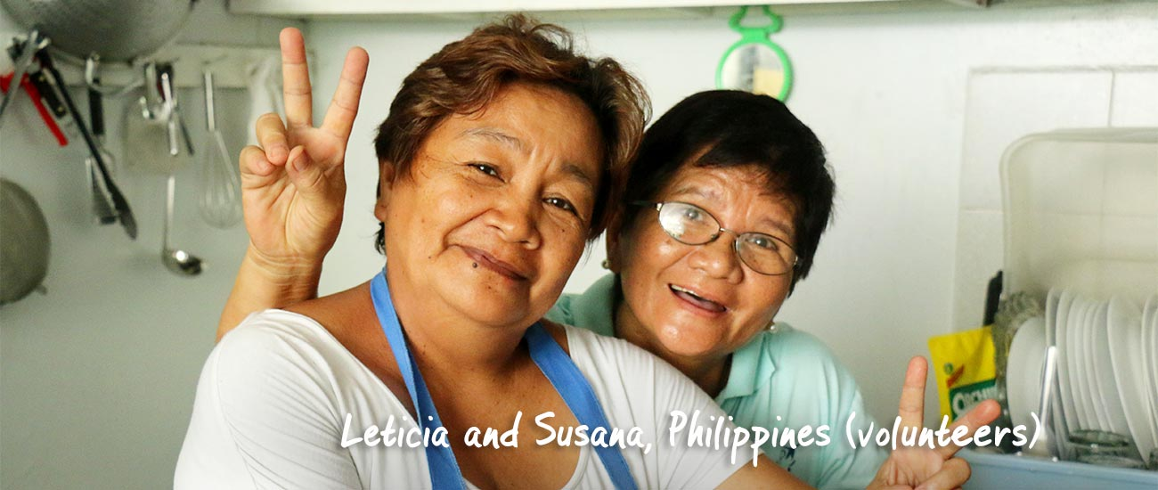 Leticia and Susana posing at community center