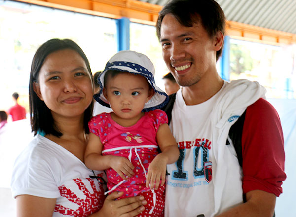 Two of Jed's sponsors, Ruth and Archie, proudly hold their adorable daughter.