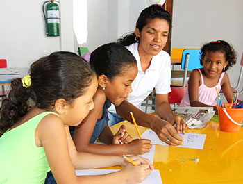 Children work on a project at a Children International library in Colombia.
