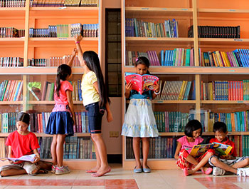 Children enjoy spending time at this community center library in the Philippines.