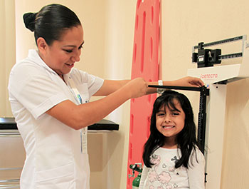 A young girl visits Children International's medical clinic for a regular checkup.