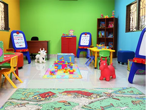 Children International provides safe places for children to learn and play, like this play area at a community center in Honduras.
