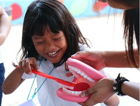 Children International teaches kids healthy behaviors, like the importance of brushing their teeth.