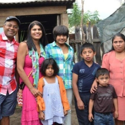 Angel More and family visiting sponsored children