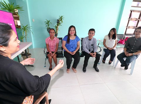 Teens participate in a career workshop.