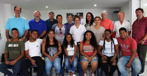 Children International staff and board members meet with youth