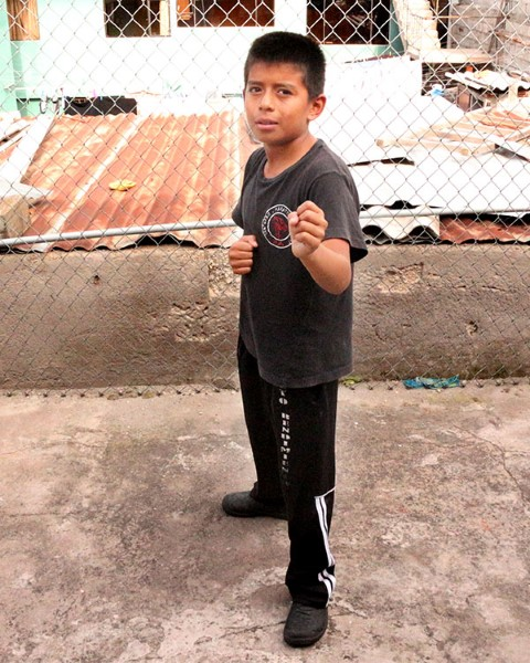 Frixon strikes a karate pose
