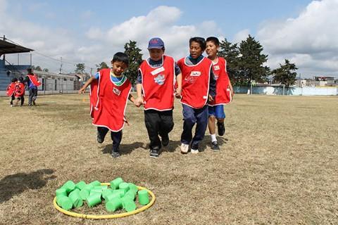 Teamwork is one important life skill kids learn in Children International's Sports for Development program.
