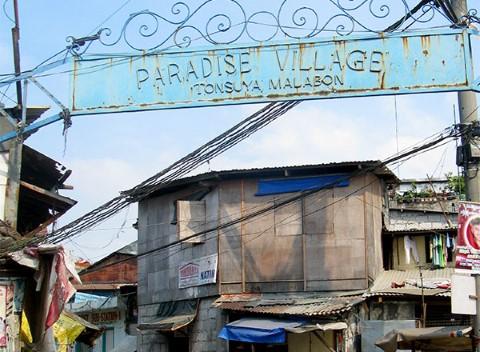 Paradise Village iron arch