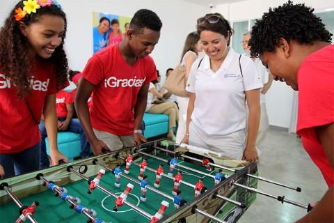 Susana referees a foosball game