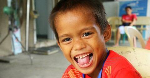 Boy in Philippines being silly