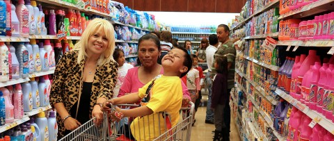 Boy enjoys a trip through the supermarket.